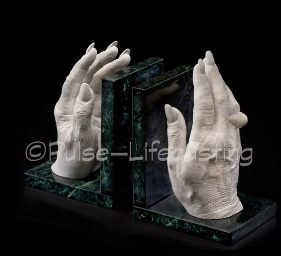 Female hands as bookends