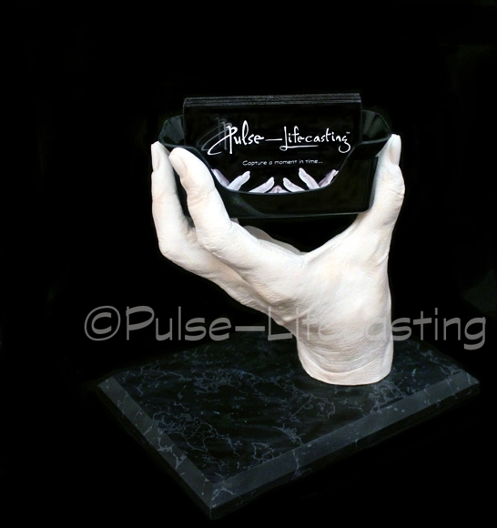 Lifecast of hand with card holder
