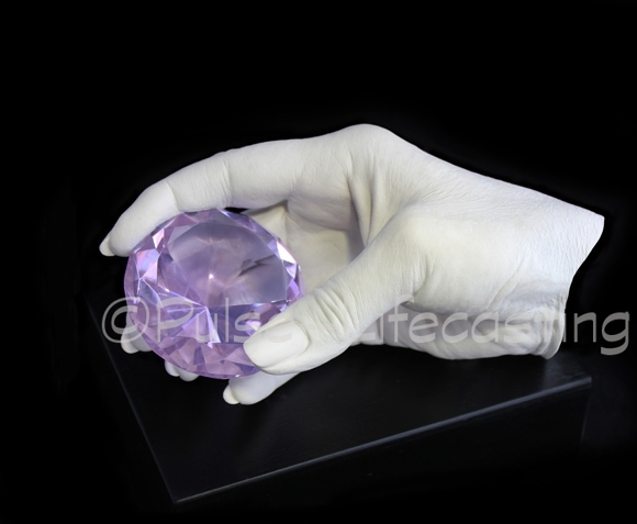 Lifecast of hand holding gem
