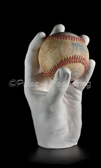 Lifecast of hand holding Baseball