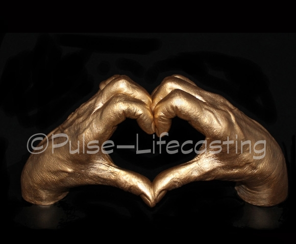 Lifecast of hands making a heart