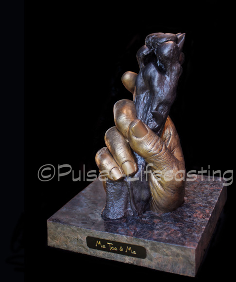 Lifecast of Dog's Paw and Owner's Hand