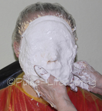 Woman getting a face cast