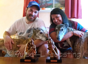 Owners with pets and paw castings